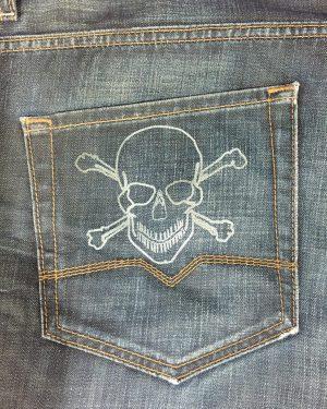 Laser engraved denim jeans